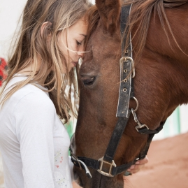 horse with gal in white shirt